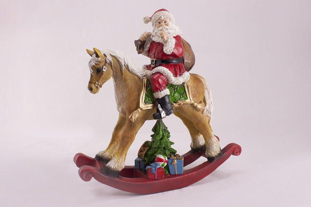 Weihnachtsmann auf Schaukelpferd handbemalt